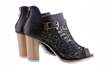 rubber sole: Female shoes with black lace white sole and a wooden heel isolated on white