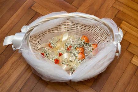 Wedding corsages in the basket Foto de archivo