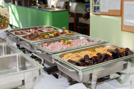 lunch tray: Blood sausage or black pudding made with pigs blood and buckwheat porridge or rice served with stewed sauerkraut in heated trays Stock Photo