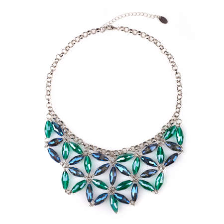 Silver necklace with blue and green rhinestones, isolated on white.