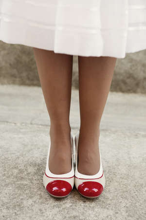 female legs: Womens legs in beige delicate tights with retro shoes, vintage filter applied