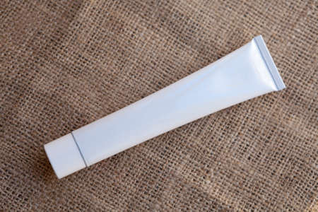 hessian: White, empty and clean tube, ready for your design product, on hessian fabric