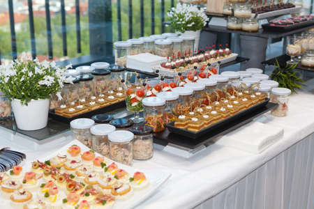 Beautifully decorated catering banquet table with different food snacks and appetizers Stok Fotoğraf