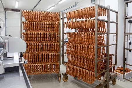 Homemade sausages on metal holders Stock Photo