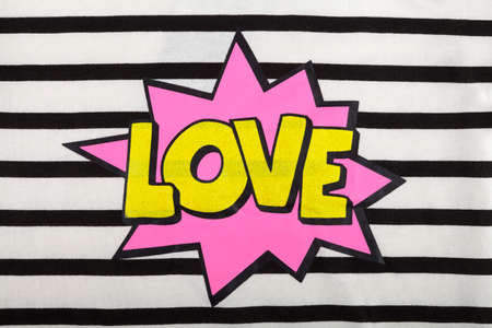 woman white shirt: Detail of a Love sign on a stripped fabric Stock Photo