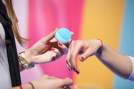 massager: Women trying beauty gadget on their hands