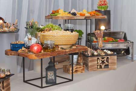 Buffet tray with fresh fruit, dry figs and grana padano cheese at the hotel breakfast, buffet catering food