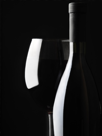 bottle with a wineglass  photo