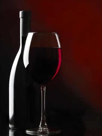 Red wine on the black background  photo
