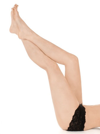 Naked female legs over white background   photo