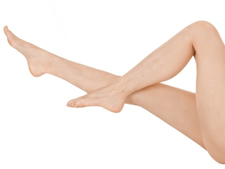 Beautiful female legs and hands  Isolated over white background   photo