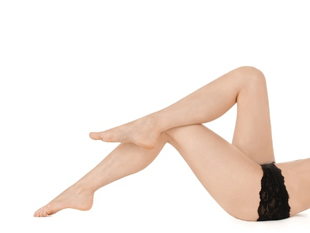 Beautiful female legs and hands  Isolated over white background   Stock Photo