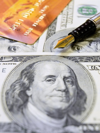 Gold credit card, us dollars and a pen Editorial