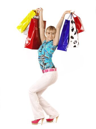 Portrait of stunning young woman carrying shopping bags against white background Stock Photo