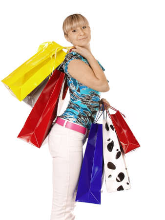 portrait young adult girl with colored bags Stock Photo