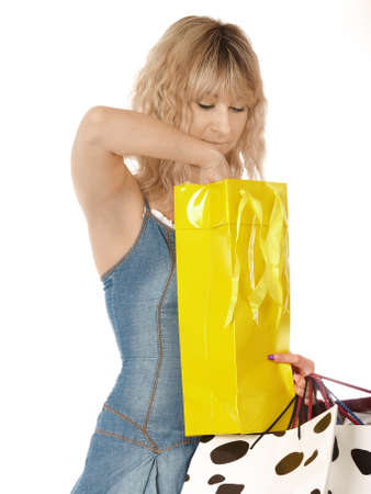 beautiful girl smiling with shopping bags in a mall Stock Photo - 13912325