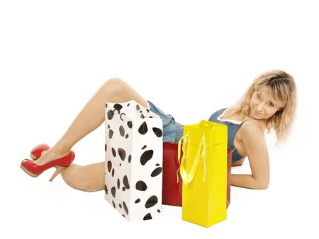 A beautiful portrait of a young attractive woman holding shopping bags and looking contemplative   Stock Photo