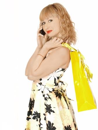 Beautiful shopping woman happy holding shopping bags