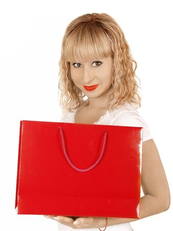 beautiful girl smiling with shopping bags in a mall