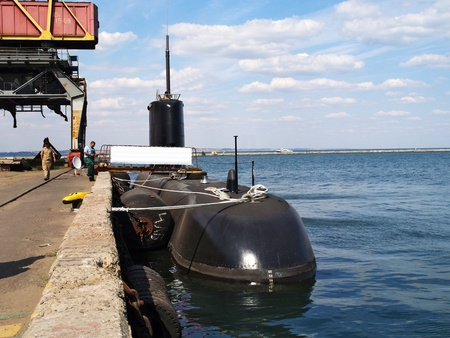 Submarine in a port bay