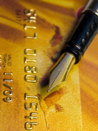 Golden Credit Card and pen photo
