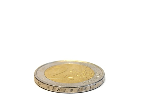 coppers: Two euro coin in front of a white backgroundisolated