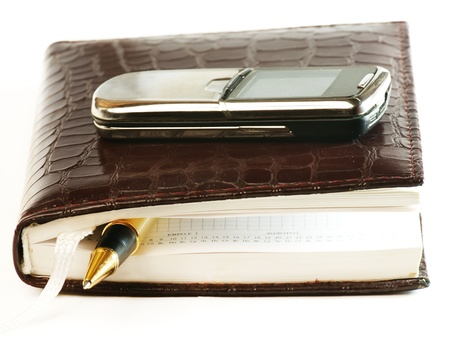 Notebook, phone  and pen for writing notes  Business note concep