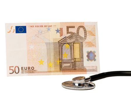 A medical stethoscope and euro Stock Photo