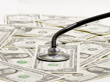 A medical stethoscope and dollar photo