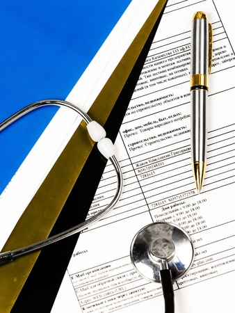 Stethoscope on a patients medical record Stock Photo