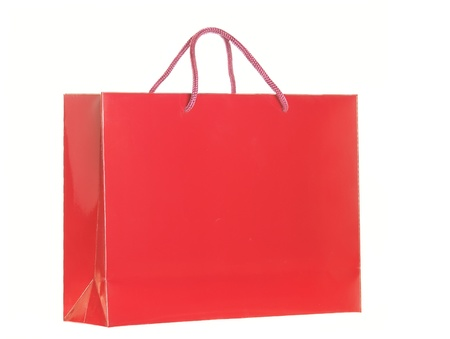 red shopping bag isolated over white background photo