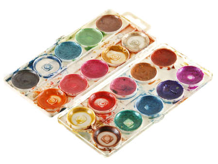 Old watercolour paints palette. Isolated on a white Stock Photo