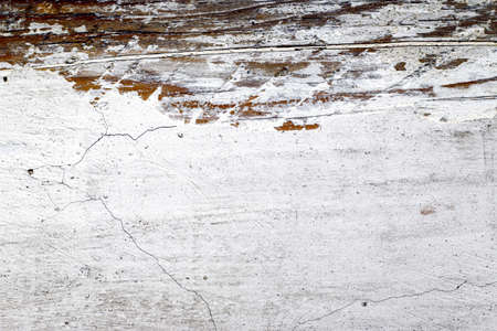 Old white surface background. White texture with scratches and cracks. Distressed grunge texture background.