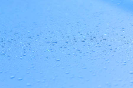 Water drops on blue metal. Water drops background. 写真素材