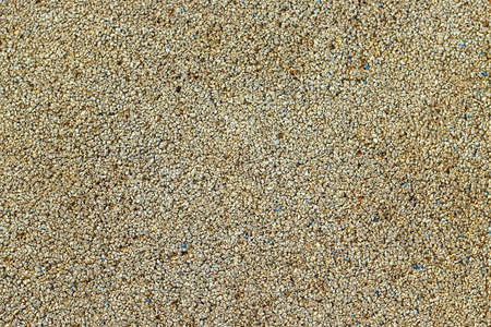 Gravel background. Gravel texture abstract background. Playground sand texture.
