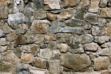 Stone wall background. Natural stones wall texture. Old castle stone wall texture background.