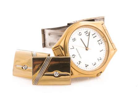 wrist cuffs: Gold watch and gold cufflinks