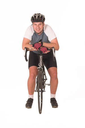 tight fitting: Cyclist resting on bicycle Stock Photo