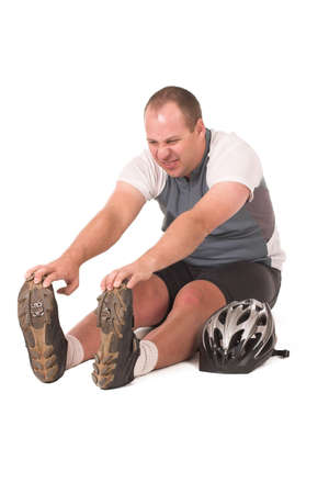 supple: Cyclist streching in pain