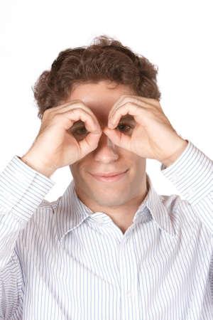 male model holding hands like binoculars Stock Photo - 4265200