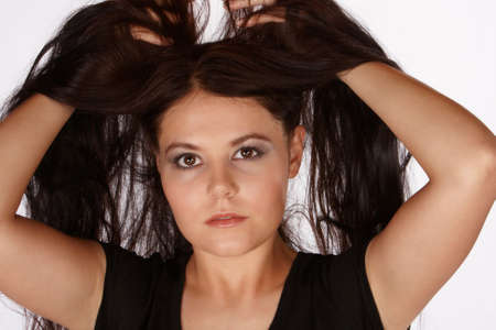 uncontrolled: Young attractive female lifting her hair above her haid Stock Photo