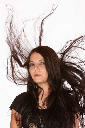 uncontrolled: Female with hair blowing upwards uncontrolled in all directions