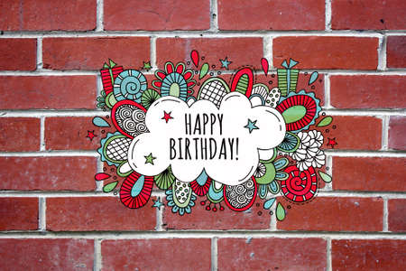 Happy Birthday Bright coloured illustration with the words happy birthday in a bubble surrounded by presents, stars, shapes and swirls on a red brick wall