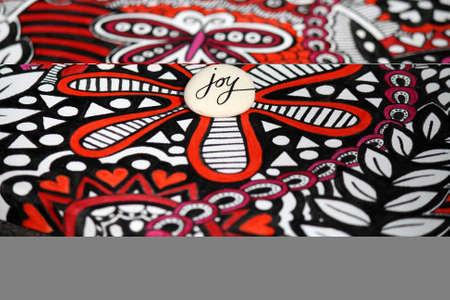 Joy Doodle Rock on Bright Mixed Media Background