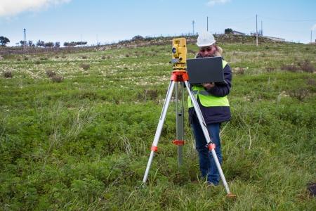 engineer with theodolite photo