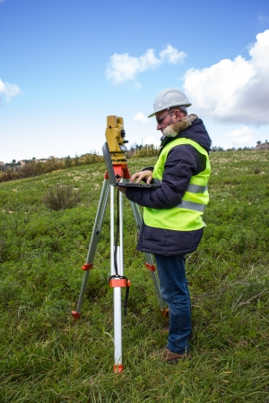 cartographer: engineer with theodolite