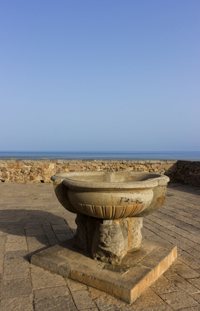 the beautiful land on the sea in Cefalu allows visitors to linger and admire the sea photo