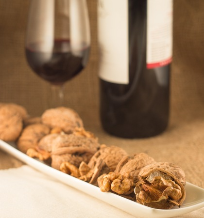 evenings: walnuts and red wine can be enjoyed in the winter evenings Stock Photo