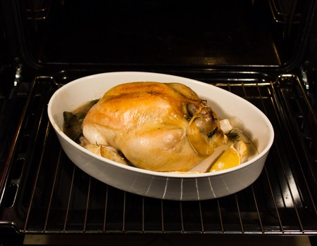 Chicken cooked in the oven with garlic rosemary lemon photo