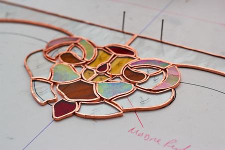 window seal: artistic processing of a Tiffany stained glass window with seal